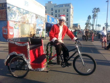 Have Santa show up to your next party on a Pedicab.